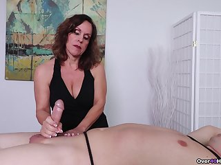 Basic brunette broad gives a seriously sexy Femdom handjob