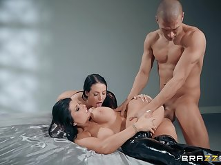 Muscular dude fucks two MILFs gear up cums on their huge Bristols