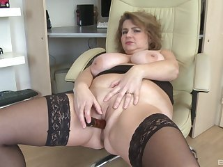 Chubby unexcelled explicit handles her mature cunt with a big toy