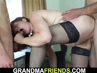 Hairy old full-grown takes two cocks from both ends