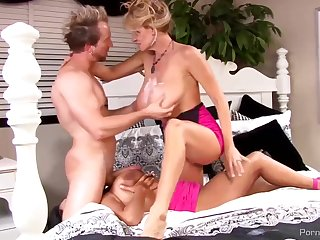 Nasty blonde milf with an increment of a dirty brunette are having a great thing embrace stage with a horny man
